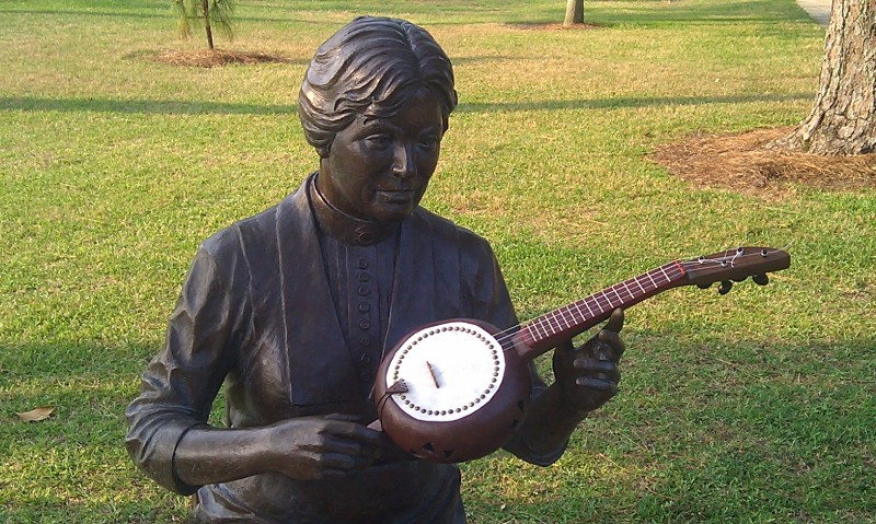 Marietta Johnson statue with banza